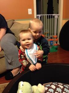 Giving his cousin Austin hugs :)