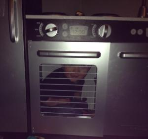 Silly boy hiding in his kitchen's oven!