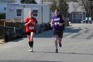 Finishing my last marathon with my new friend- a man running for the Pancreatic Cancer Action Network