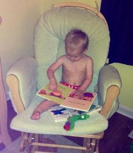 Reading books all by himself... upside down :)