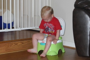 Wearing his big boy underwear and practicing sitting on the potty