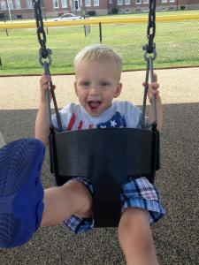 Loves the swings!