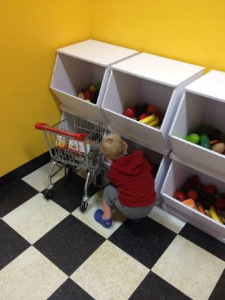 Pretending to grocery shop at the children's museum. He loved it!