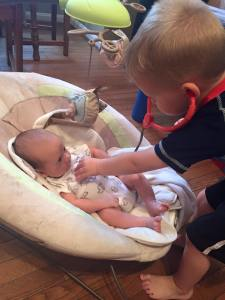 Big brother checking little brother's heartbeat