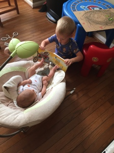 Reading a book to his brother