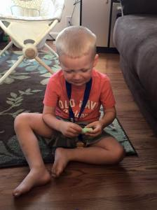 Throwing a fit because his chalk broke and he wanted me to put it back together...