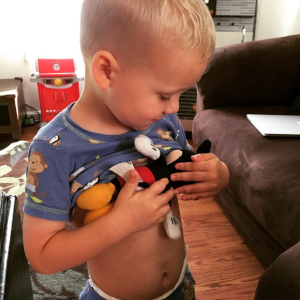 He wanted to feed his Mickey like mommy feeds Kyler :)